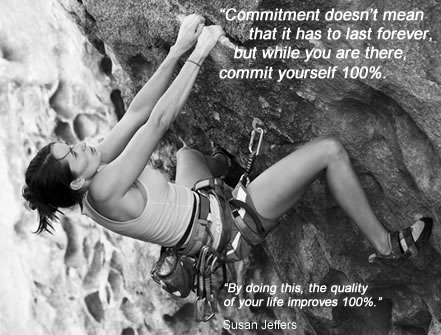 Fear of commitment image - woman climbing on rock